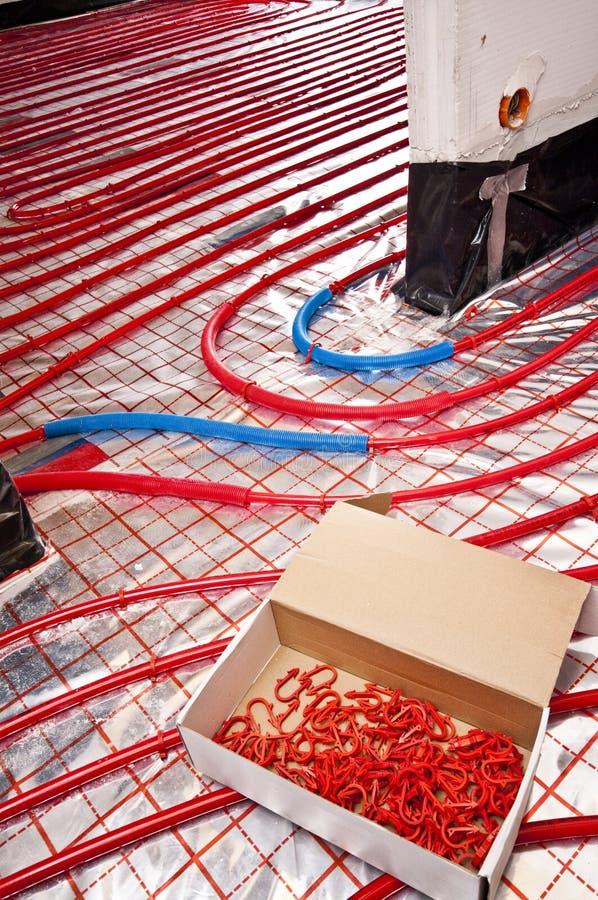 Clips de la instalación de la calefacción de piso imagen de archivo libre de regalías