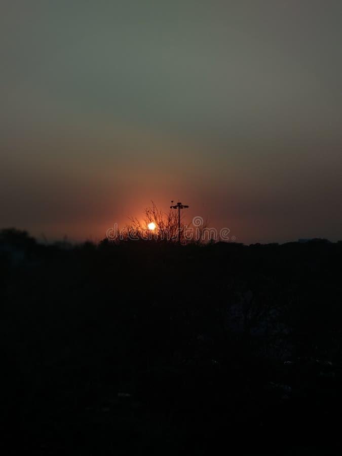 clique ajustado do PIC do tempo do sol fotos de stock
