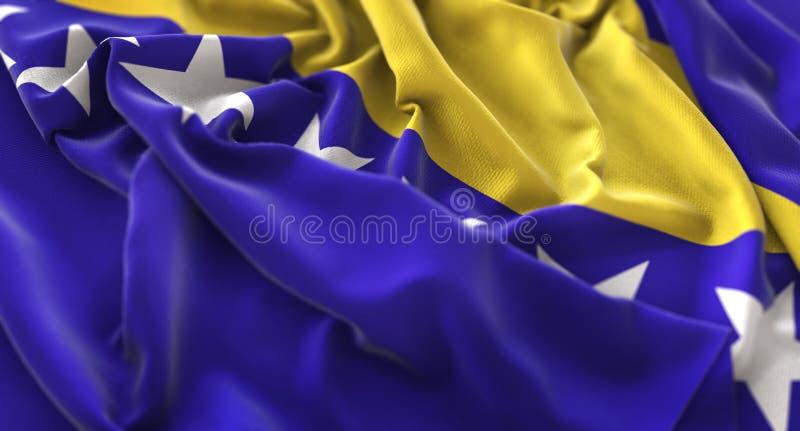 Clo macro belamente de ondulação enrugado da bandeira de Bósnia e de Herzegovina imagens de stock royalty free