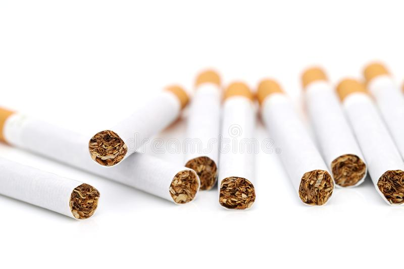 Cloae up of cigarette. Isolated on white background royalty free stock photo