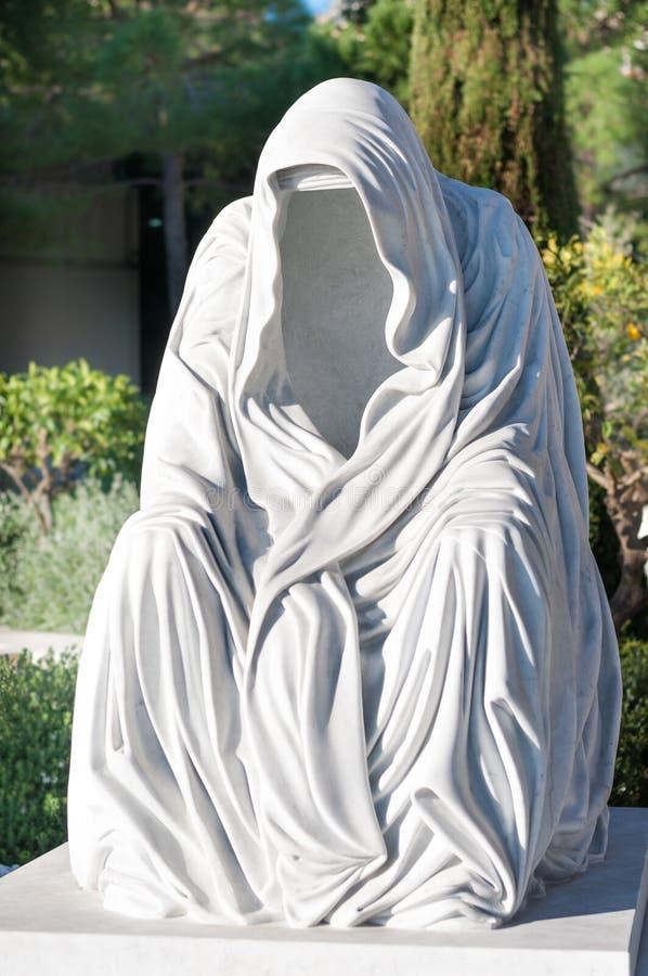 The Cloak of Conscience. ` Le manteau de la conscience ` by Anna Chromy , 2014.The Cloak of Conscience is the culmination of numerous depictions of a faceless royalty free stock photo