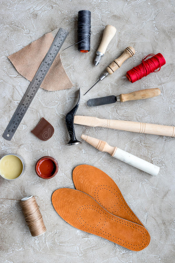 Clobber preparing his tools for work. Grey stone desk background top view.  stock photo