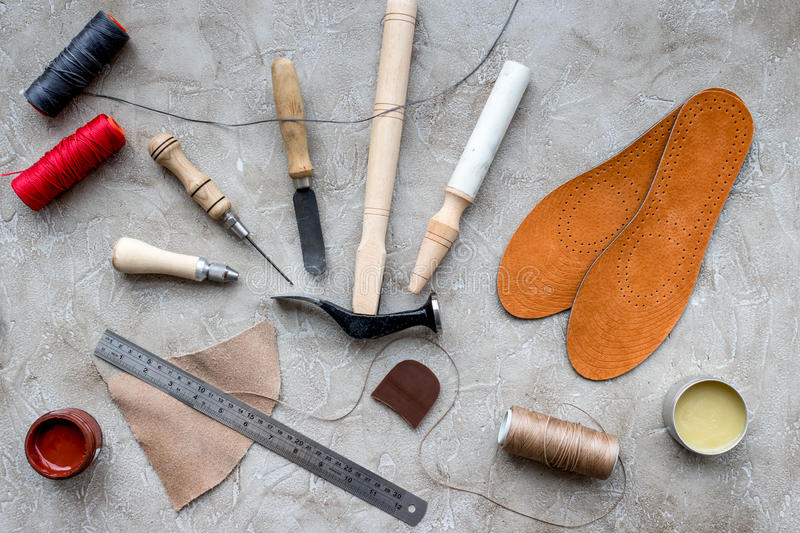 Clobber preparing his tools for work. Grey stone desk background top view.  royalty free stock photography