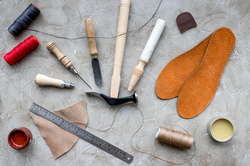 Clobber preparing his tools for work. Grey stone desk background top view.  stock images