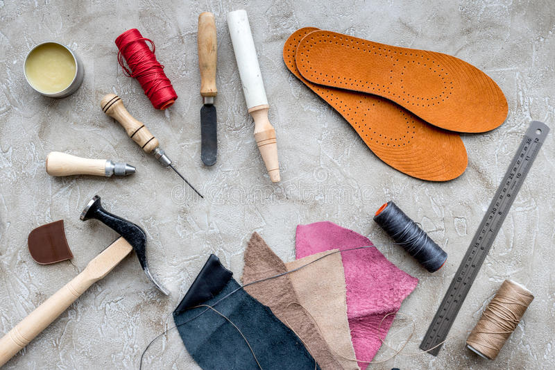Clobber preparing his tools for work. Grey stone desk background top view.  royalty free stock photos