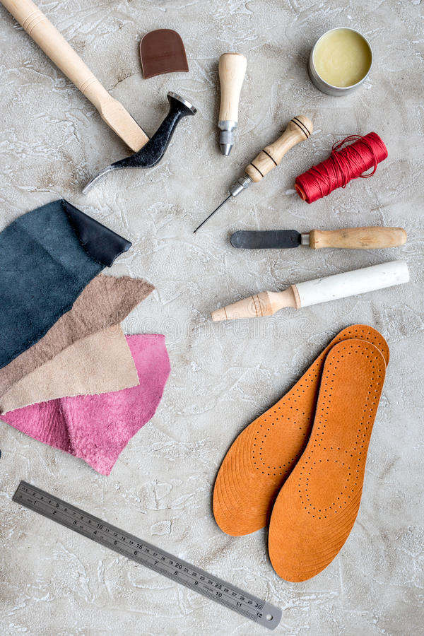 Clobber preparing his tools for work. Grey stone desk background top view.  royalty free stock image