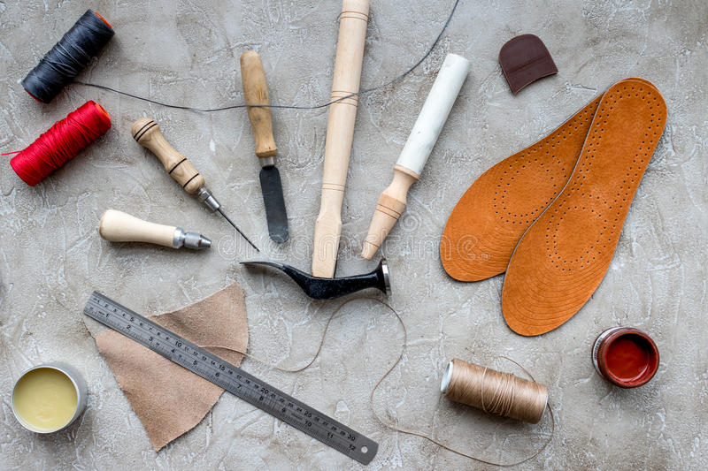 Clobber preparing his tools for work. Grey stone desk background top view.  stock photos