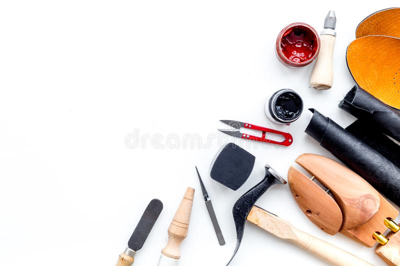 Clobber tools. Hummer, awl, knife, sciccors, wooden shoe, paint and leather. White background top view space for text. Clobber tools on white background top view royalty free stock image
