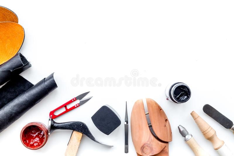Clobber tools. Hummer, awl, knife, sciccors, wooden shoe, paint and leather. White background top view space for text. Clobber tools on white background top view royalty free stock images