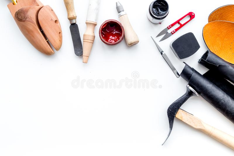 Clobber tools. Hummer, awl, knife, sciccors, wooden shoe, paint and leather. White background top view space for text. Clobber tools on white background top view stock images