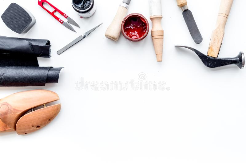 Clobber tools. Hummer, awl, knife, sciccors, wooden shoe, paint and leather. White background top view space for text. Clobber tools on white background top view royalty free stock photos