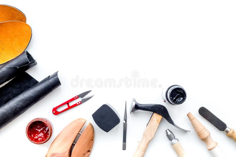 Clobber tools. Hummer, awl, knife, sciccors, wooden shoe, paint and leather. White background top view space for text. Clobber tools on white background top view royalty free stock photography
