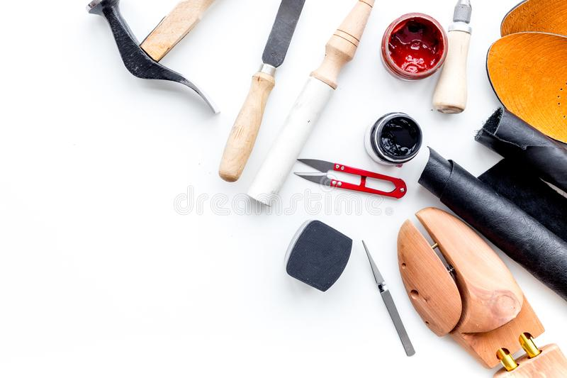 Clobber tools. Hummer, awl, knife, sciccors, wooden shoe, paint and leather. White background top view space for text. Clobber tools on white background top view royalty free stock photo