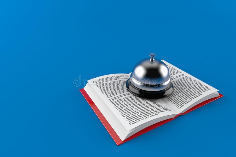 Cloche d'hôtel sur le livre ouvert illustration libre de droits