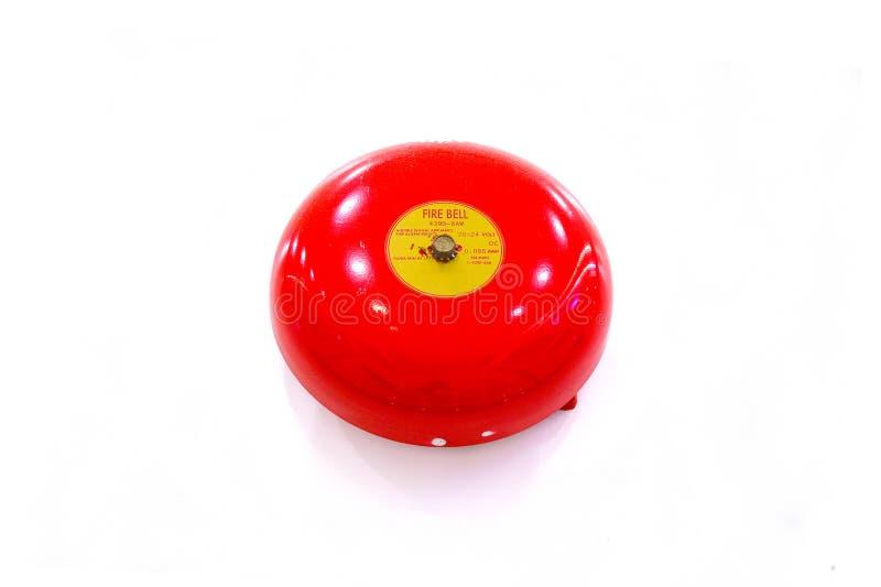 Cloche rouge d'alarme d'incendie ou de feu d'isolement sur le fond blanc (Selec photo libre de droits