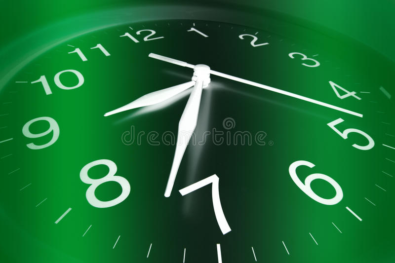 Clock. Close Up of Clock Face with Green Background stock image