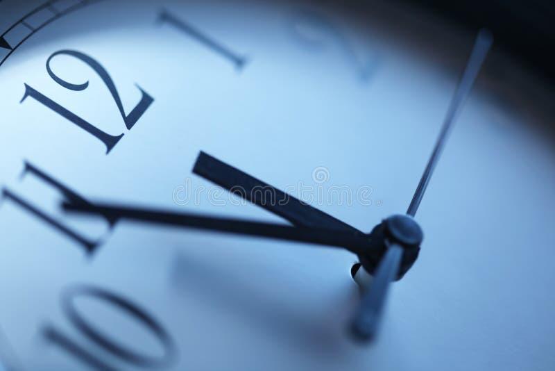 Clock. Closeup in blue tones