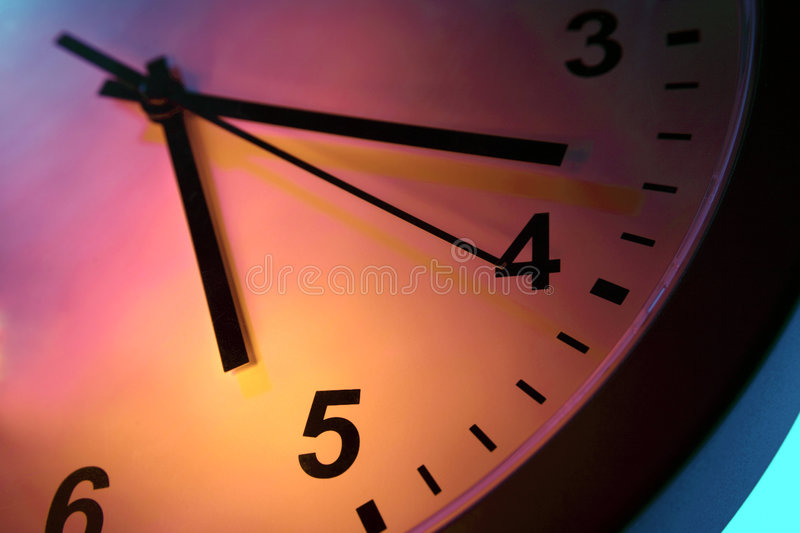 Clock. A close-up image of a clock showing all three: hour, minute and seconds hands royalty free stock photos