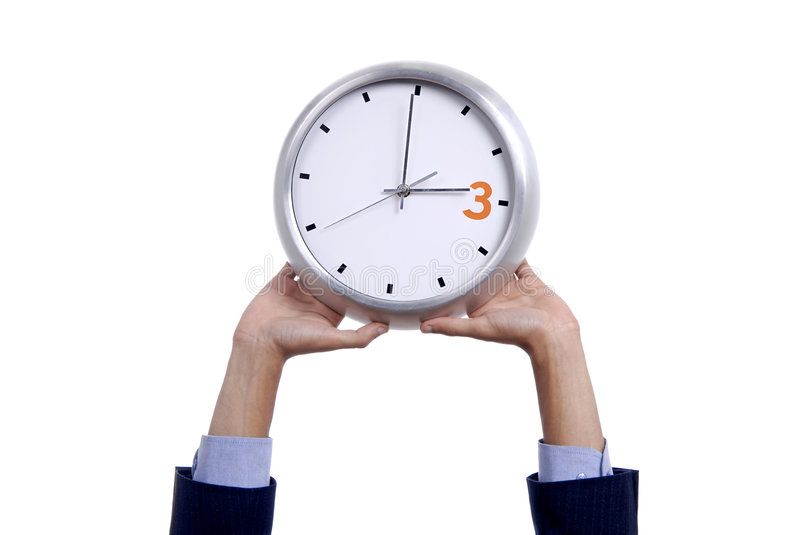 Clock. Business man with a clock isolated in white background stock photos
