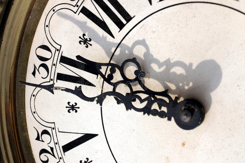 Clock. Showing short before six stock photography