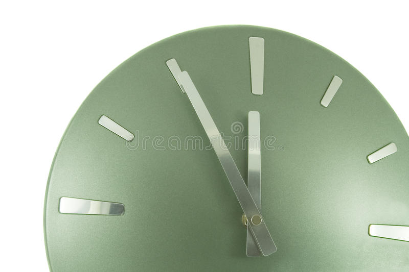 Clock (5 minutes to 12). Over white royalty free stock photos