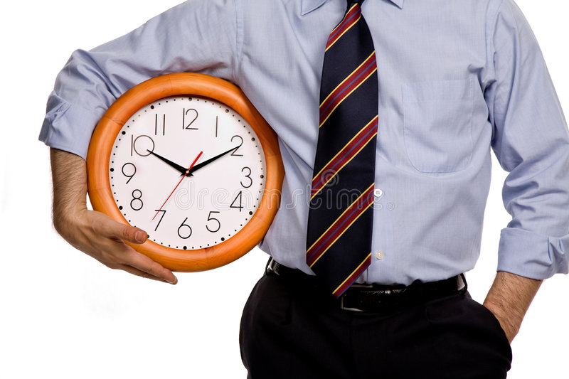 Clock. Business man with a clock on white background royalty free stock image