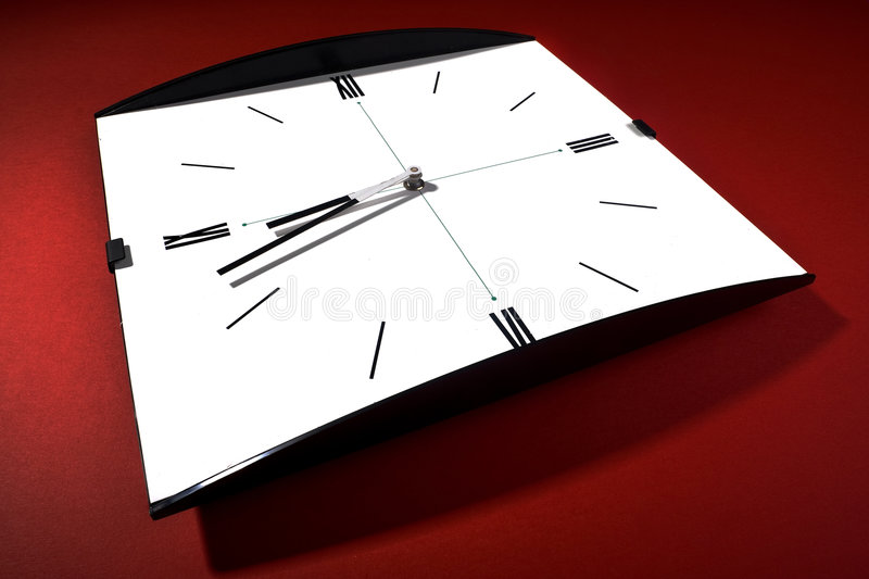 Clock. Wide angle shot of a clock on red background royalty free stock photography