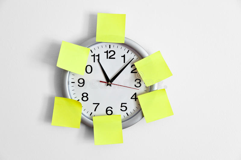 Download Clock and Adhesive Note stock image. Image of white, hand - 14294335