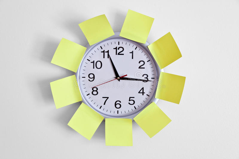 Clock and Adhesive Note. Close up stock photo