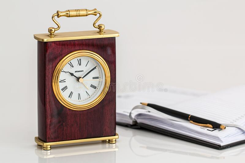 Clock and appointment book royalty free stock image