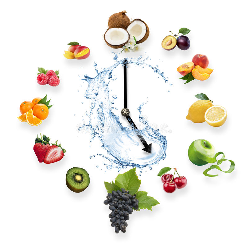 Clock arranged from healthy fruits splash by water isolated on w royalty free stock image