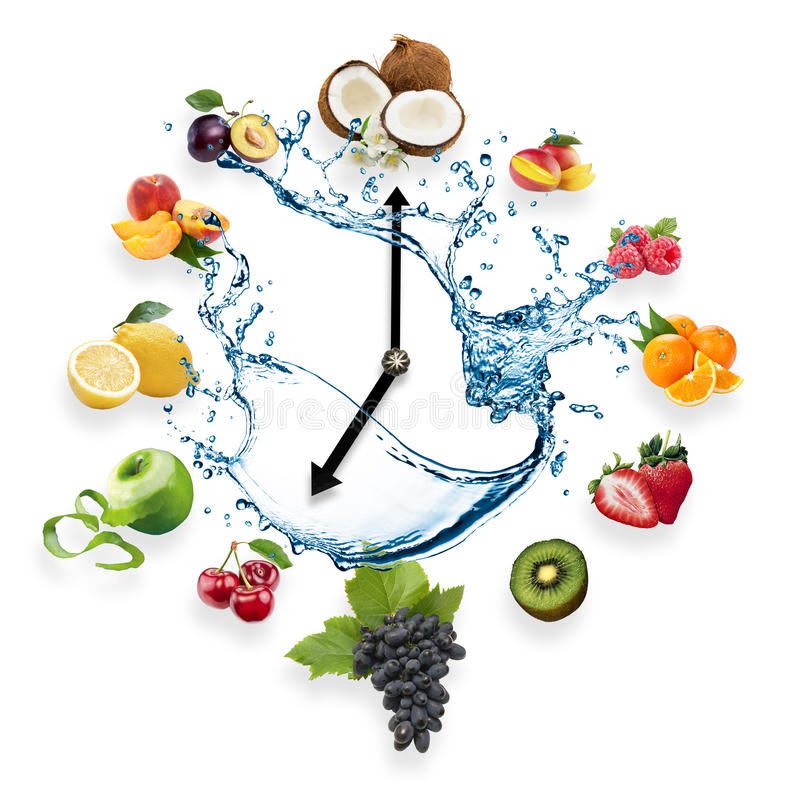 Clock arranged from healthy fruits splash by water isolated on w. Hite background. Food clock with fruits. Healthy food concept royalty free stock photos