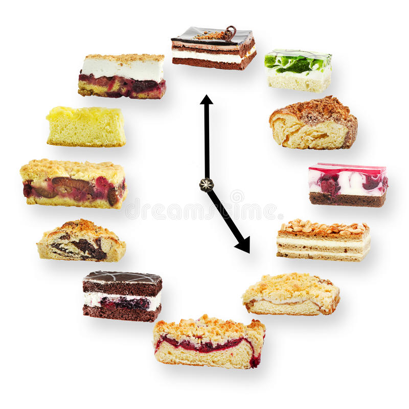 Clock arranged from home made cakes on white background stock image
