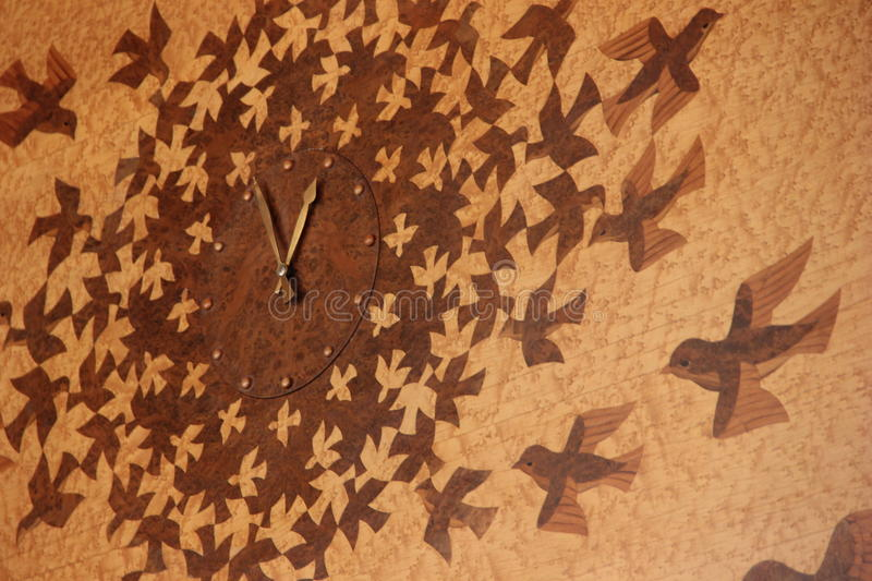 A clock with birds pattern stock images