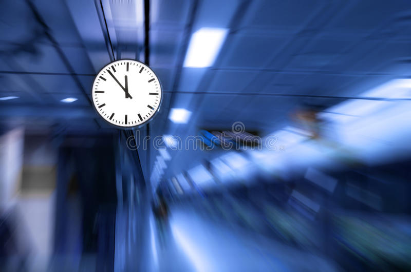 Clock blurred ,conceptual image of time running or passing away effect zoom out. Alarm clock to movements stock photography