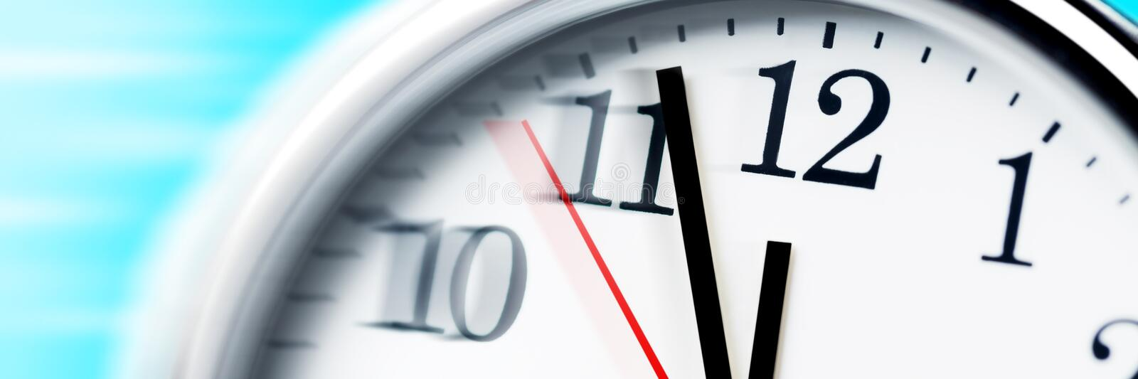 Running Out Of Time!. Clock with blurred hands and numbers. Running Out Of Time Concept stock image