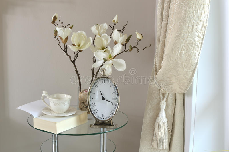 Clock, Book and Cup by Window royalty free stock photo