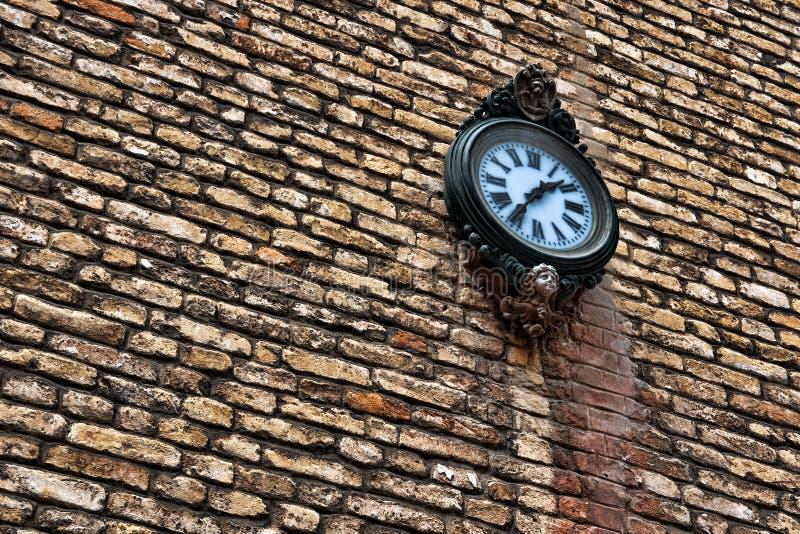 Clock on brick wall stock photos
