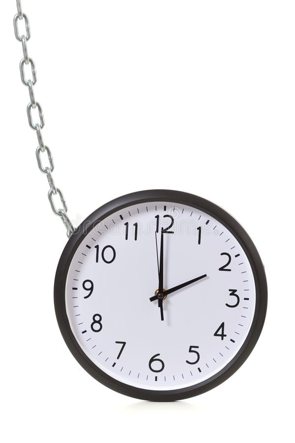 Clock is chained, the concept of time management. stock images