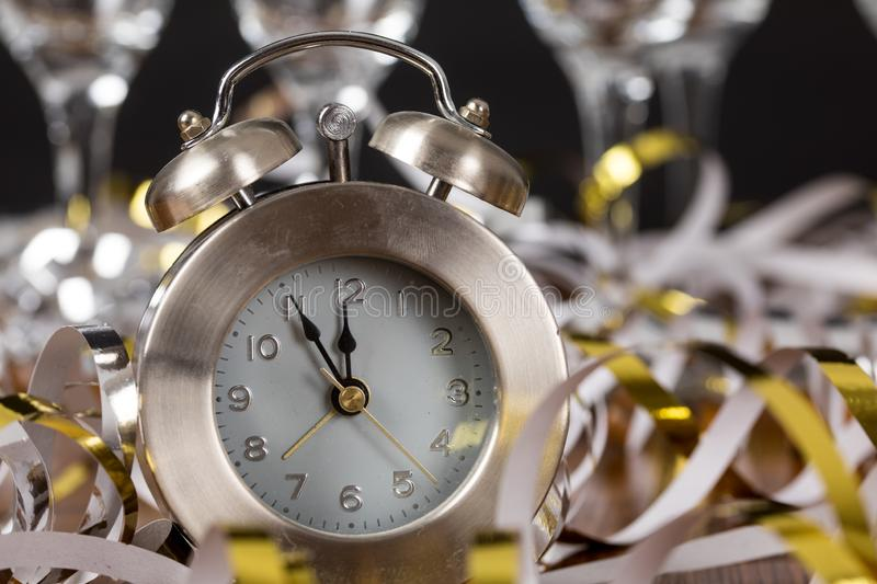 Clock with champagne silvester new year party stock photography
