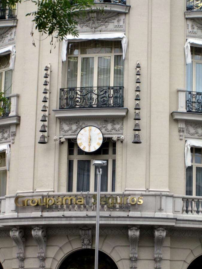Clock with chime of the Plus Ultra building - Groupama - Madrid Spain. NOld Building Plus Ultra. José Ignacio Cortés Bretón installed the clock with a royalty free stock image