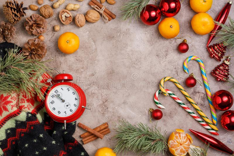 Clock. Christmas background. New Year`s holiday. Christmas motive Top view. Free space for your text. Flat lay stock photos