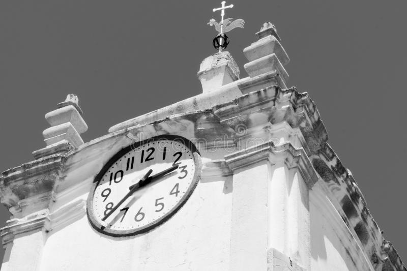 Clock on Church Tower with Cross. In Black and White stock images