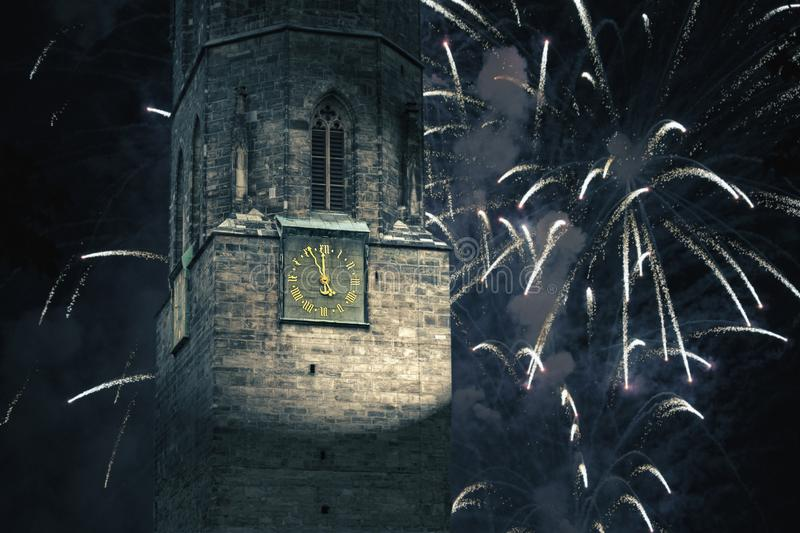 Clock on the city tower shows five minutes to twelve on New Year royalty free stock photo