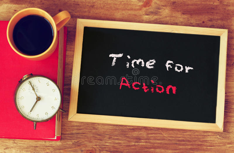 Clock, coffee cup and blackboard with the phrase time for change.  stock photography