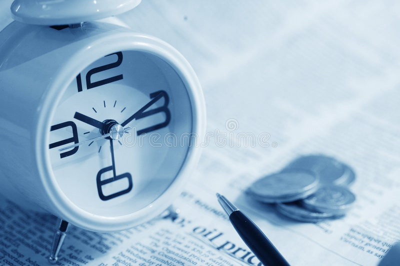 Clock And Coin On Newspaper Royalty Free Stock Image