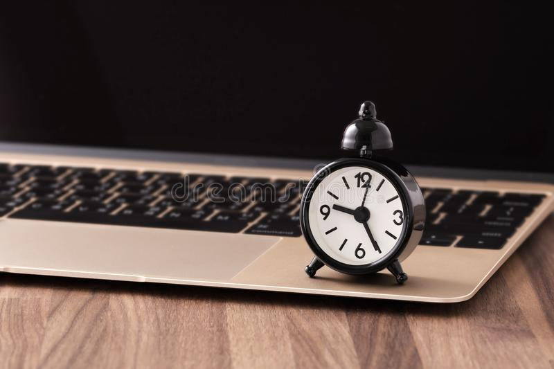 Clock on computer Time management concept stock image