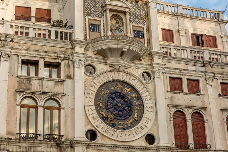 Clock dell`Orologio on St Mark`s Square San Marc in Venice, Italy. Detail with clock face and astrological Zodiac signs.  stock photo