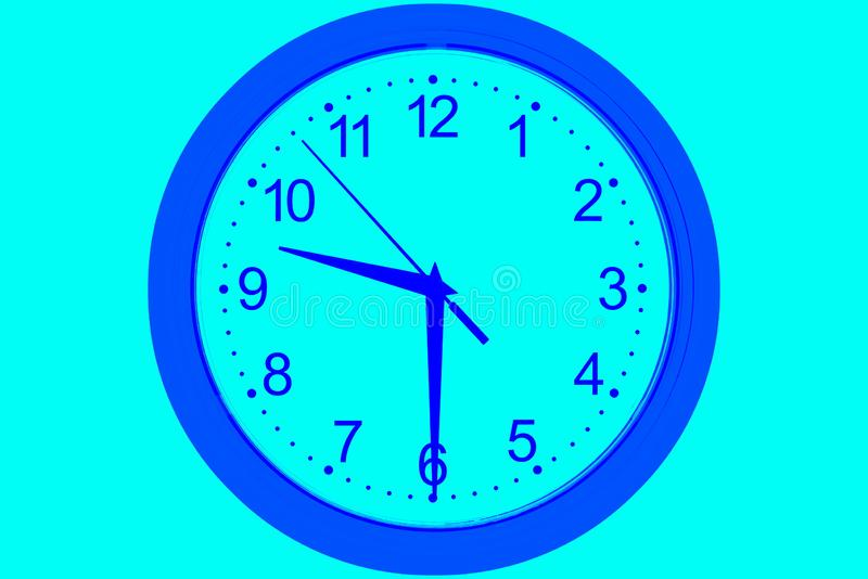 Clock dial on a green blue background stock images