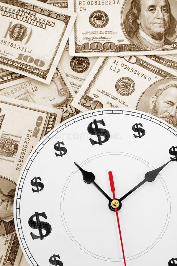 Clock and dollars royalty free stock photo